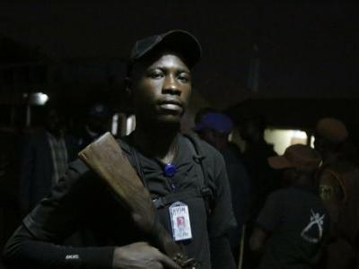 In Nigeria vote, armed vigilantes work to keep the peace