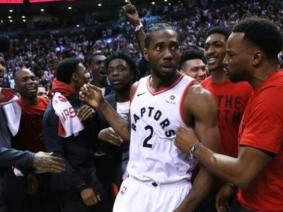 Stunning photo captured the Raptors and Sixers watching Kawhi Leonard's series-winning shot bounce around the rim