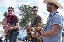 LANCO Jams on Top of a Bus & Tries a Beer Bong at Faster Horses Festival: Watch