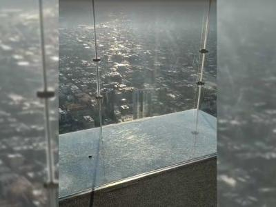 The SkyDeck ledge of the Willis Tower in Chicago cracks under visitors' feet