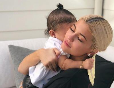 Kylie Jenner Snuggles Up To Smiling Baby Stormi In Rare Mommy-Daughter Clip - Watch!