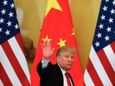 Trump doubles down on claims that China and the EU are currency manipulators and warns: 'I'll still win'
