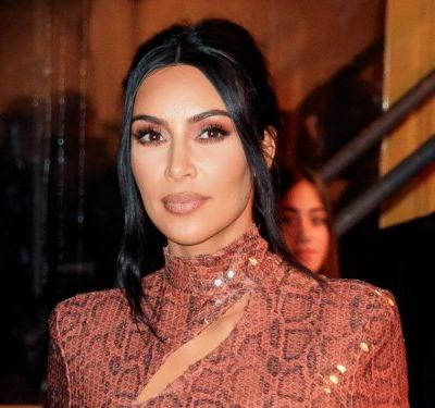 Kim Kardashian turned heads in a vintage snakeskin dress covered in sparkly sequins