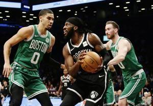 Russell scores 34, Nets send Celtics to 3rd straight loss