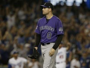 Taylor HR in 10th, Dodgers top Rockies 3-2, pad NL West lead
