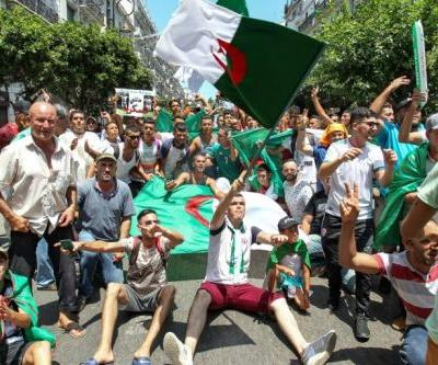 Algerians mix protest with football as cup final looms