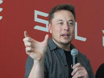 Tesla reports smaller loss than expected, beats on revenues