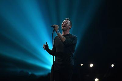 """Watch Brit Awards' George Michael Tribute: Chris Martin Sings """"A Different Corner,"""" Wham!'s Andrew Ridgeley Introduces"""