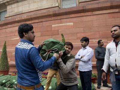 India budget offers tax cuts, handouts for poor farmers
