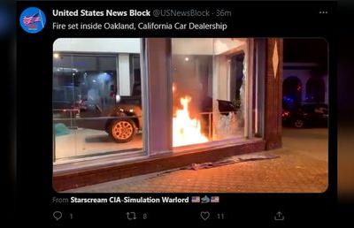 Protesters smash windows & set fires in Oakland as anger over recent police shootings spreads across US
