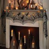 This Light-Up Hocus Pocus Mantel Scarf Features the Sanderson Sisters Flying Over Salem