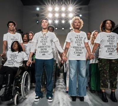 Grenfell activists take over London Fashion Week catwalks to demand justice