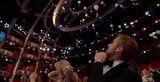 Ryan Gosling Staring at Candy Falling From the Ceiling at the Oscars Is All of Us