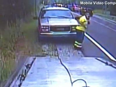 'I looked and saw the car rolling': Video shows tow truck driver nearly hit by SUV