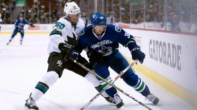 Pacific-leading Sharks easily handle undermanned Canucks