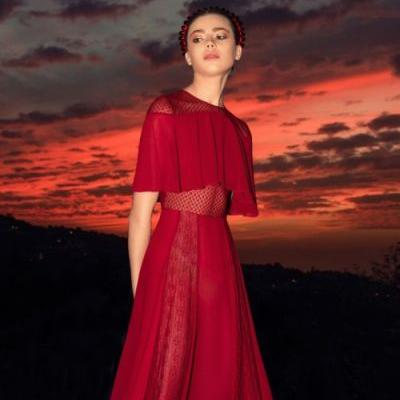 An integrated bolero top makes this a one-of-a-kind rouge gown!