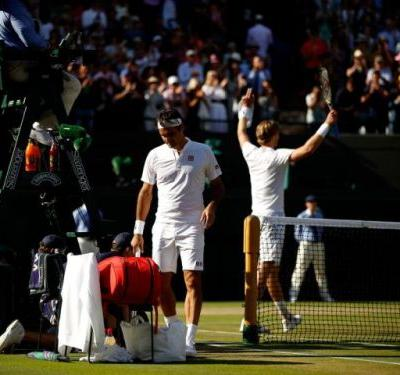Kevin Anderson surges from two sets down to stun Roger Federer in marathon Wimbledon quarter-final