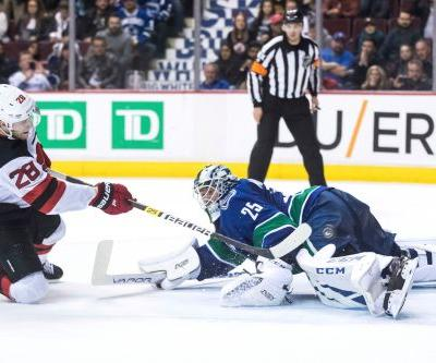 Devils outlast Canucks to win marathon shootout