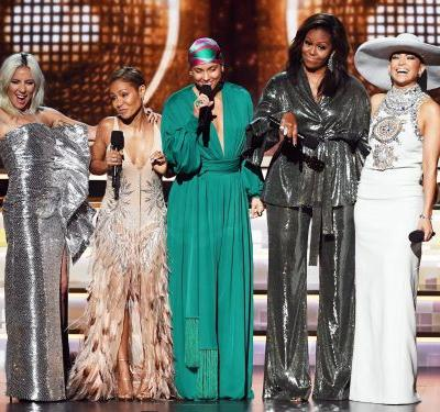 Celebrities lost their minds when Michelle Obama made a surprise appearance on the Grammys stage