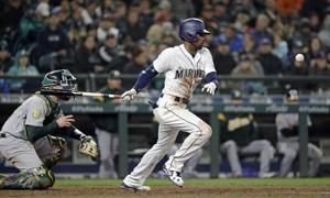 Homer happy Mariners hit 4 long balls in 10-8 win over A's