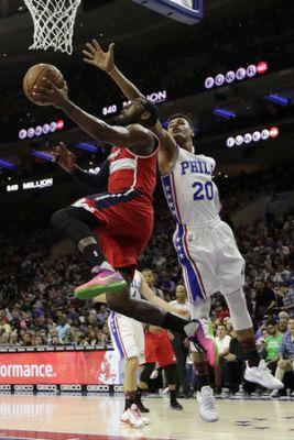 Covington, Saric lead Sixers to 120-112 win over Wizards