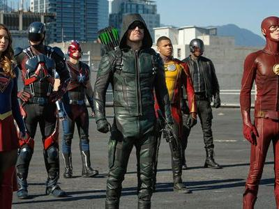 First Look At The Arrow-verse Crossover Reveals The Bat-Signal And Premiere Date