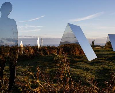 Mirrored Figures Reflect the Natural Landscape and Cultural Heritage of Morecambe Bay