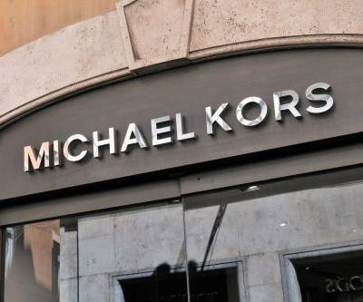 Michael Kors shares sink amid Versace rumors