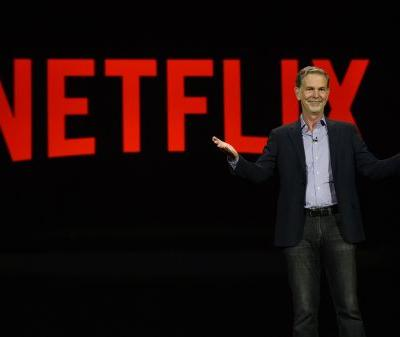 Netflix surges above $400 for the first time after a slew of Wall Street bullishness