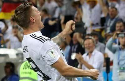 Kroos keeps Germany's World Cup hopes alive with late stunner