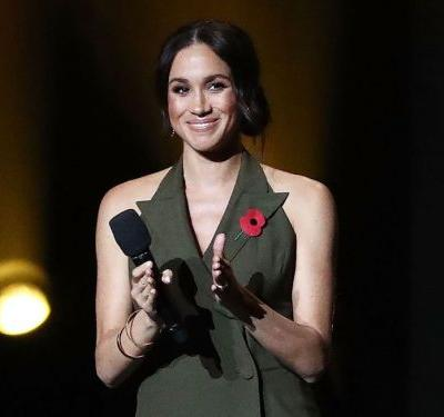 Meghan Markle wore a new sleeveless tuxedo dress, and the style is becoming a staple in her royal wardrobe