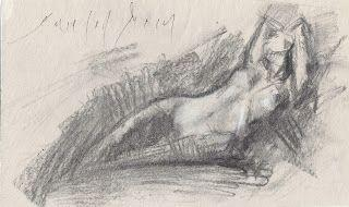 Female nude laying with hands under her head