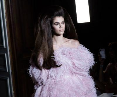 Kaia Gerber is somewhere under this massive hairdo