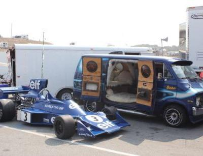 The Coolest Car At The Monterey Motorsports Reunion Is This Custom Van With an F1 Car