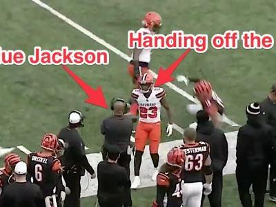 Browns cornerback intercepts the Bengals, hands the ball to ex-head coach Hue Jackson after play