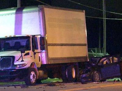 Driver crashes into parked truck, critically hurt