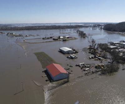 Record flooding is devastating the Midwest and could saddle Nebraska's farmers with nearly $1 billion of damage