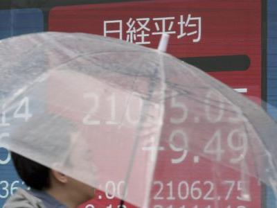 Asian shares mostly higher as China-US trade talks drag on
