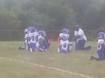 8-year-old football players kneel during national anthem