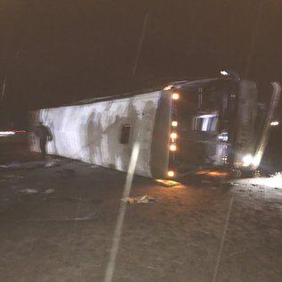 Bus carrying members of UW marching band rolls over on I-90