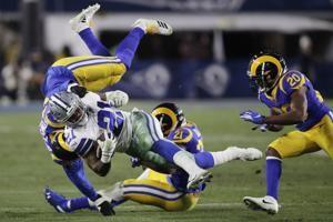 Grounded: Cowboys' running game, defense struggles vs. Rams