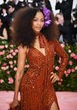 Zoe Saldana Quite Literally Dazzled in This Fiery Orange Gown at the Met Gala
