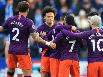 Manchester City cruise against Huddersfield, reduce Liverpool's lead at top