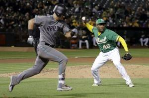 A's reliever Casilla goes on DL with shoulder strain