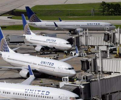 A United passenger's laptop battery caught fire mid-flight, forcing the pilot to make an emergency landing in Florida