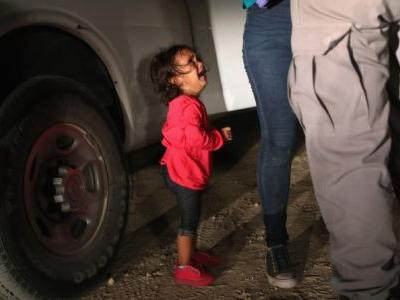 The Story Behind The 'Little Girl' Photo That's Turning The World Against Trump's Border Policy