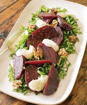 Roasted beetroot with sorrel, walnuts & onion dressing