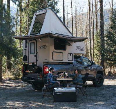 This $19,980 camper is mounted on top of a pickup truck and can sleep up to 6 people - see inside