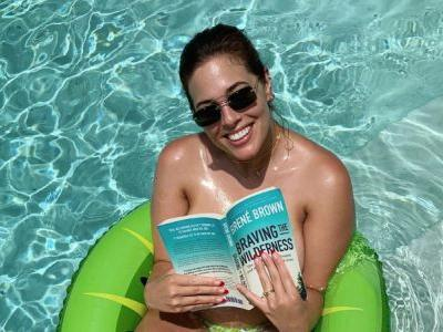 Ashley Graham Is the Definition of Sexy and Smart as She Reads a Book While Topless in the Pool