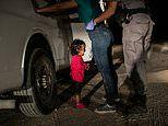 Honduran child watching her mother being searched on the US-Mexico border is voted photo of the year